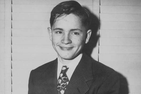A young Charles Manson in a suit and tie three days before he ran away from Boys Town.