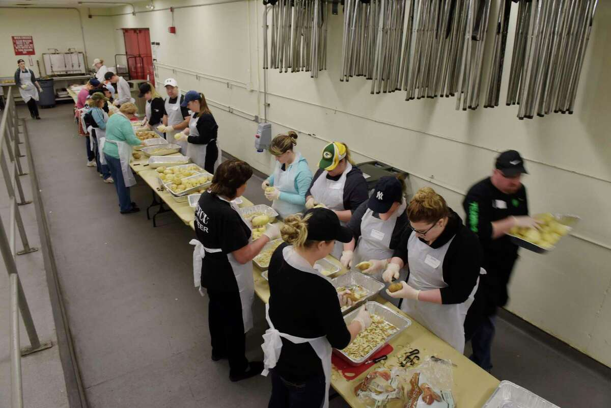 Volunteers peel potatoes as they did the prep work for the 48th Annual Thanksgiving Community Dinner at the Empire State Plaza on Sunday, Nov. 19, 2017, in Albany, N.Y. Equinox, through the help of 3,500 volunteers, will serve 10,000 meals this Thanksgiving, 9,500 of those will be delivered to people. Those looking to help by delivering meals should call to register, 518-434-0131. (Paul Buckowski / Times Union)