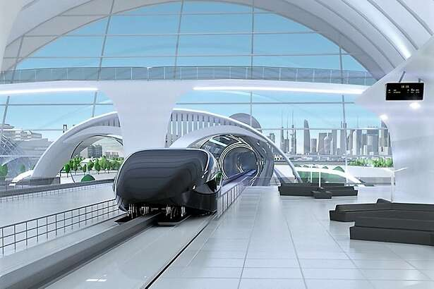 An artist's conception shows a Hyperloop pod parked at a transit station.