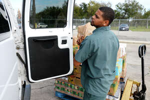 Ramon Mouton loads food into a van for an agency at the Southeast Texas Food Bank on Thursday.  Photo taken Thursday 11/16/17 Ryan Pelham/The Enterprise
