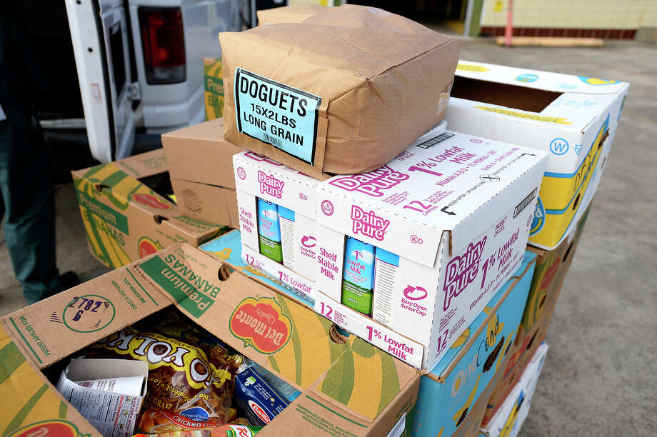 Boxes of food sit on a pallet before being loaded into a van at the Southeast Texas Food Bank on Thursday.  Photo taken Thursday 11/16/17 Ryan Pelham/The Enterprise Photo: Ryan Pelham / ©2017 The Beaumont Enterprise/Ryan Pelham