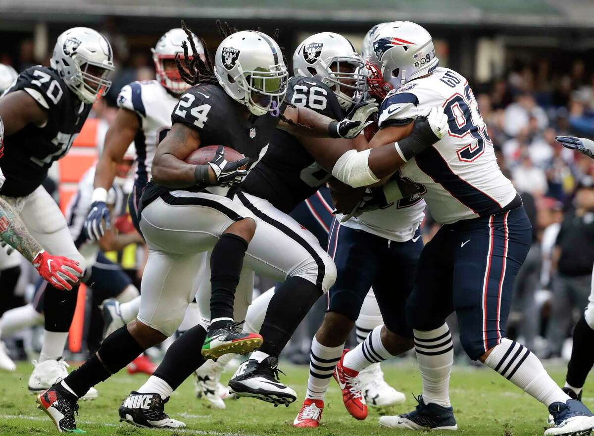 Oakland Raiders running back Marshawn Lynch (24) rushes against the New England Patriots during the first half of an NFL football game Sunday, Nov. 19, 2017, in Mexico City. (AP Photo/Rebecca Blackwell)