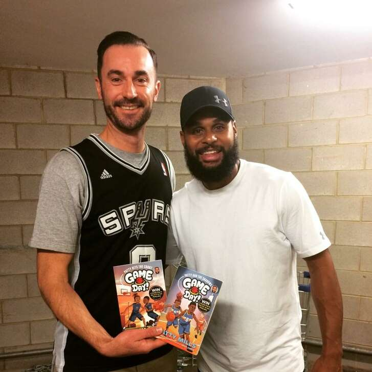Spurs guard Patty Mills with Nahum Ziersch, an Australian artist who has illustrated a series of children's books featuring Mills.