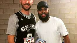 Spurs guard Patty Mills with Nahum Ziersch, an Australian artist who has illustrated a series of children's books featuring Mills.