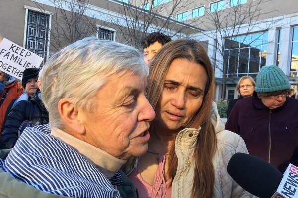 The Rev. Gini King, left, comforts Miriam Martinez who may be deported today to Guatemala.