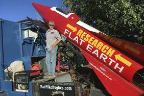 In this Wednesday, Nov. 15, 2017, photograph, daredevil/limousine driver Mad Mike Hughes is shown with with his steam=powered rocket constructed out of salvage parts on a five-acre property that he leases in Apple Valley, Cal. Hughes plans to launch his homemade contraption on Saturday near the ghost town of Amboy, Cal., at a speed of roughly 500 miles-per-hour. (Waldo Stakes/HO courtesy of Mad Mike Hughes via AP)