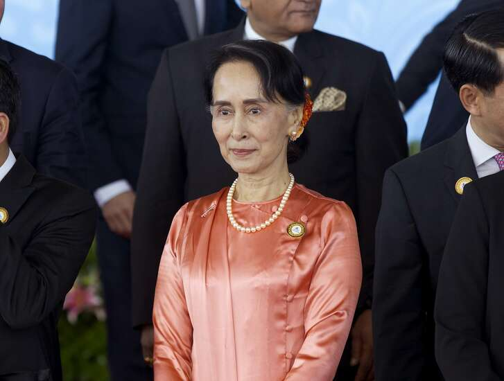 Myanmar's Foreign Minister Aung San Suu Kyi poses with other counterparts of members of the Asia Europe Foreign Ministers (ASEM) for a group photo before their meeting at Myanmar International Convention Centre Monday, Nov. 20, 2017, in Naypyitaw, Myanmar. (AP Photo/Thein Zaw)