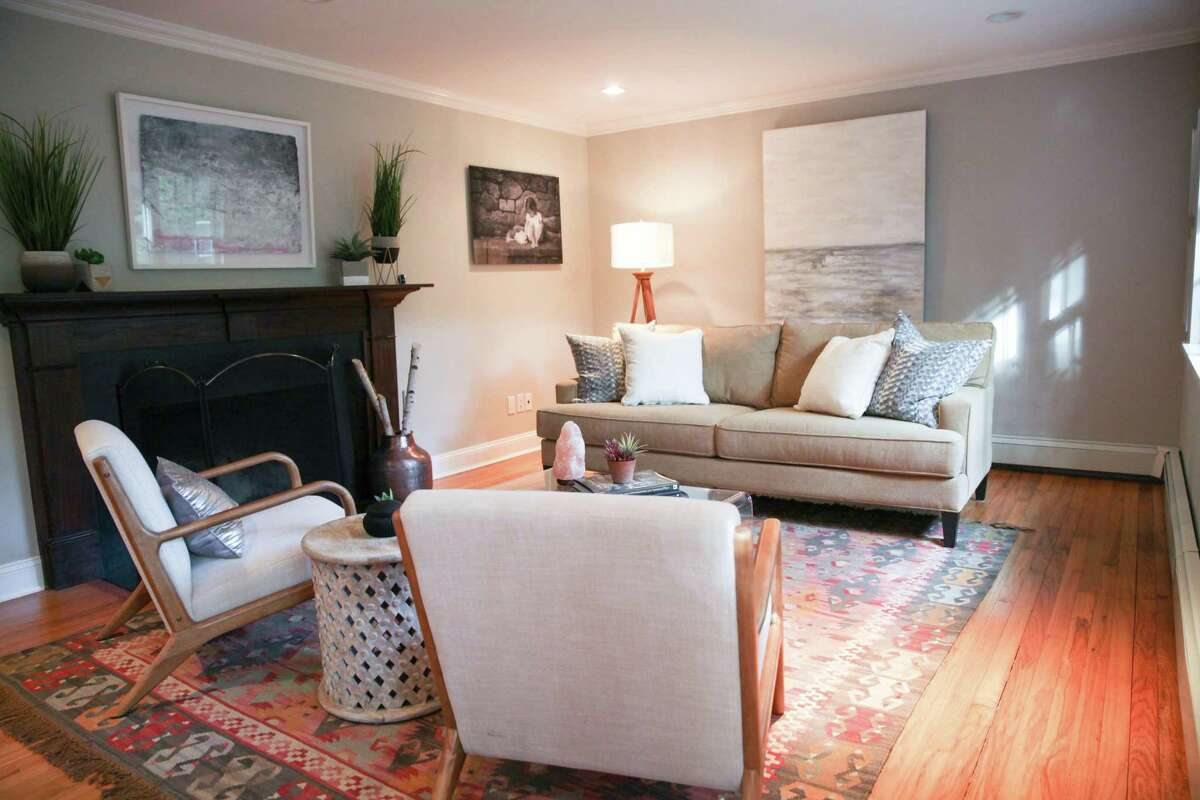 In the formal living room there is a fireplace.