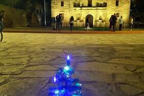 Steve Monreal has been setting up miniature trees at downtown landmarks as a way of marking where the tree-lighting ceremony should have taken place if it had to be moved from Alamo Plaza.