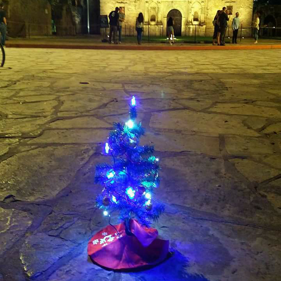 Steve Monreal has been setting up miniature trees at downtown landmarks as a way of marking where the tree-lighting ceremony should have taken place if it had to be moved from Alamo Plaza. Photo: Courtesy, Steve Monreal