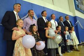 Fathers and daughters pose for a picture at the Father Daughter Dance at the Westport Weston Family Y, Friday, Nov. 17, 2017, in Westport, Conn.