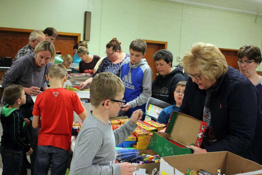 About 60 people gathered Thursday evening as Cross Lutheran Church sponsored Operation Christmas Child at the Pigeon VFW Hall. Church officials were hoping to fill about 500 boxes, so that children around the world would have something to open for Christmas. Representatives from Bay Shore Camp were on hand to box up the packages to be sent overseas. Photo: Brenda Battel/Huron Daily Tribune