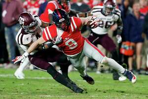 Mississippi wide receiver Tre Nixon (4) is tackled by Texas A&M defensive back Derrick Tucker (4) during the first half of an NCAA college football game in Oxford, Miss., Saturday, Nov. 18, 2017. Texas A&M won 31-24. (AP Photo/Rogelio V. Solis)