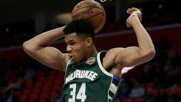 Milwaukee Bucks forward Giannis Antetokounmpo dunks during the second half of an NBA game at Detroit Pistons on Nov. 3, 2017.