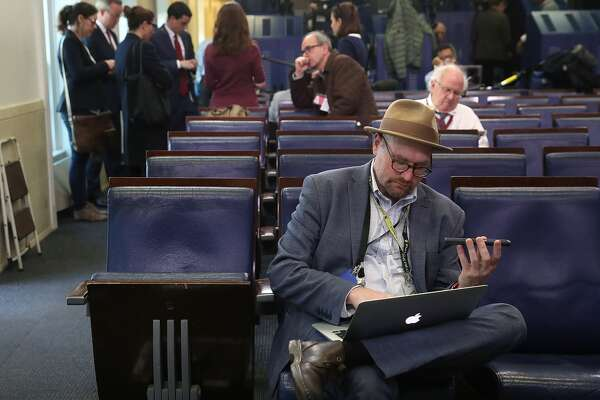 New York Times reporter Glenn Thrush works in the Brady Briefing Room after being excluded from a press gaggle by White House Press Secretary Sean Spicer, on February 24, 2017 in Washington, DC. The New York Times, Los Angeles Times, CNN and Politico were also excluded from the off camera gaggle.