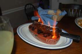 Chorica Grelhada, a spicy grilled sausage at the Atlantic Restaurant, comes on a mini-grill lit by high-bouncing flames.