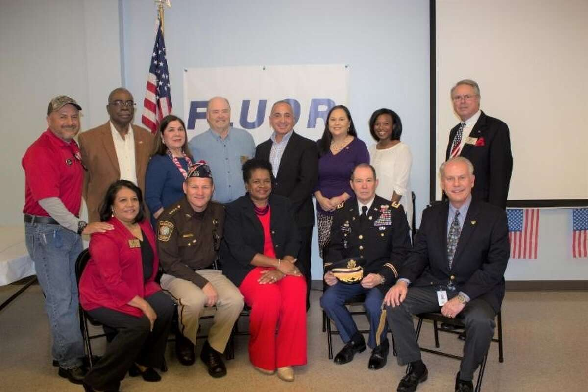 FBS Board, Fluor and Local Honorees: (front from left) Manuela Arroyos, CEO; Sheriff Troy Nehls; Barbara Jones, Sr. Manager of Community Relations and Community Affairs, Fluor; Colonel Tom Goodfellow; Commissioner Vincent Morales; (back row from left) Ray Aguilar, FBS Chairman; Erle Gooding, FBS Board Member; Lupe Uresti-Cabello, FBS Board Member; Greg Shockling, FBS Board Member; Robert Gracia, FBS Board Member; Vicki Luna, Community and Public Affairs Coordinator, Fluor; Crystal Harris, Communications Specialist, Fluor; Rick Forlano, Veteran and FBS Board Member.