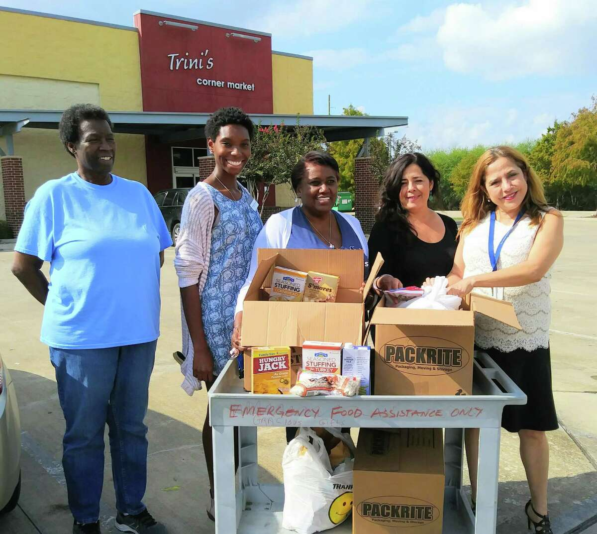 Accepting the grocery donation from Sienna Plantation are, from left, Flora Jackson, Arnelle Mitchell with Sienna, Gladys Brumfield, Mary Ann Precopio and Angelica Barcus.