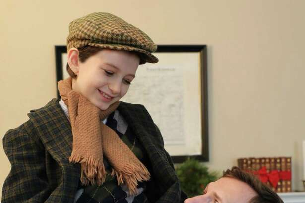 Matt Gibson as Bob Cratchit andRobert Berson as Tiny Tim.
