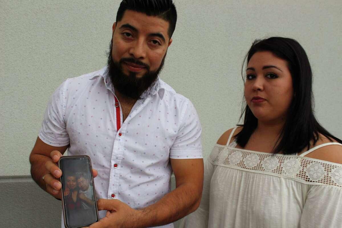 Aureliano Mendoza and his girlfriend,Autumn Garcia hold a picture of Mendoza's deceased brother, Ervin Mendoza.