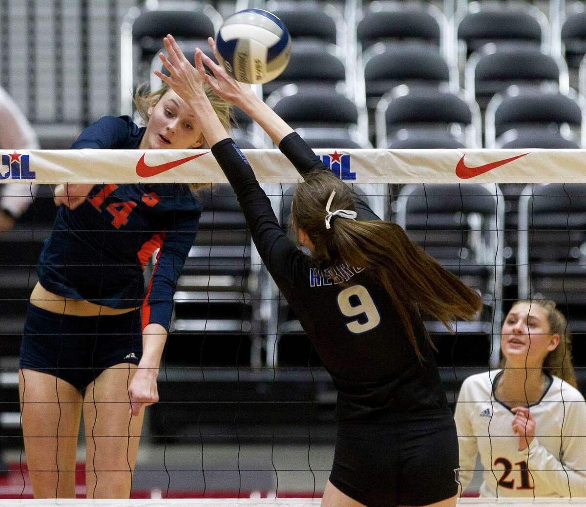 Katy Seven Lakes middle blocker Ally Batenhorst (14) gets a shot past Lewisville Hebron right side hitter Jessica Stancliff (9) during the first set of the Class 6A state championship at the Curtis Culwell Center, Saturday, Nov. 18, 2017, in Garland.