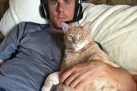 Matt Duffy and his cat Skeeter.