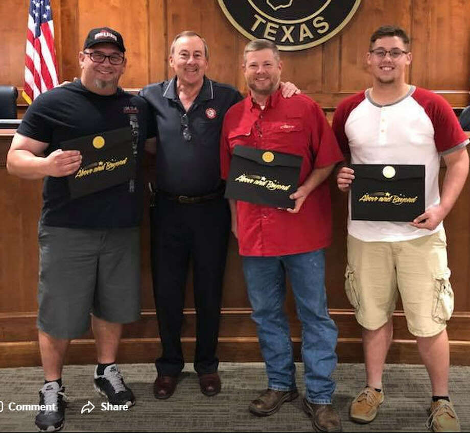 Katy Mayor Chuck Brawner and City Council honored Harvey Heroes at their Nov. 13 City Council meeting. From left are: Doug Johnson, Brawner, Pat Lester and Lane Johnson. Brawner said they rescued more than 300 people Aug. 26-27. Photo: City Of Katy