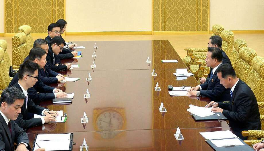 "This picture taken on November 17, 2017 and released by North Korea's official Korean Central News Agency (KCNA) on November 18, 2017 shows Song Tao (3rd L), head of the International Liaison Department of the Central Committee of the Communist Party of China, attending a meeting with Choe Ryong Hae (2nd R), member of the Presidium of the Political Bureau of the Central Committee of the Workers' Party of Korea, in Pyongyang. Diplomat Song Tao is visiting the North on behalf of China's President Xi Jinping to brief officials on the recent Chinese Communist Party congress and other ""issues of mutual interest"", foreign ministry spokesman Geng Shuang said. He is the first major Chinese envoy to visit Pyongyang in more than a year with ties severely strained between the two countries. / AFP PHOTO / KCNA VIA KNS / - / South Korea OUT / REPUBLIC OF KOREA OUT   ---EDITORS NOTE--- RESTRICTED TO EDITORIAL USE - MANDATORY CREDIT ""AFP PHOTO/KCNA VIA KNS"" - NO MARKETING NO ADVERTISING CAMPAIGNS - DISTRIBUTED AS A SERVICE TO CLIENTS THIS PICTURE WAS MADE AVAILABLE BY A THIRD PARTY. AFP CAN NOT INDEPENDENTLY VERIFY THE AUTHENTICITY, LOCATION, DATE AND CONTENT OF THIS IMAGE. THIS PHOTO IS DISTRIBUTED EXACTLY AS RECEIVED BY AFP.  / -/AFP/Getty Images Photo: -, AFP/Getty Images"