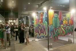 Scene at HUE Mural Festival Preview event downtown Houston.