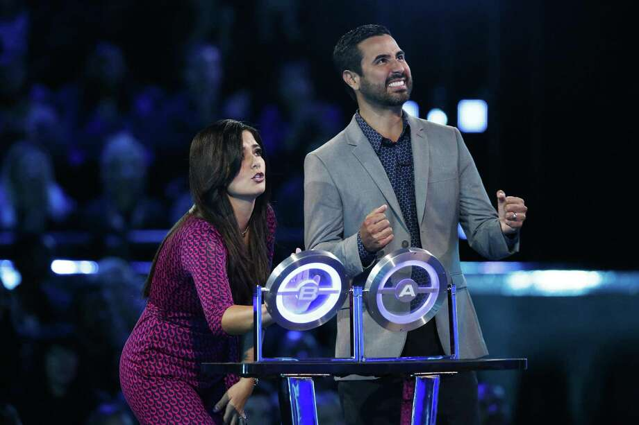 """Dentist Ruben Mora of San Antonio, who's known for his generosity with patients, and his wife, UTSA alumna Sandy, compete on a special Thanksgiving week edition of NBC's hit game show """"The Wall,"""" hosted by Chris Hardwick. Photo: Justin Lubin /NBC /Justin Lubin /NBC / 2017 NBCUniversal Media, LLC"""