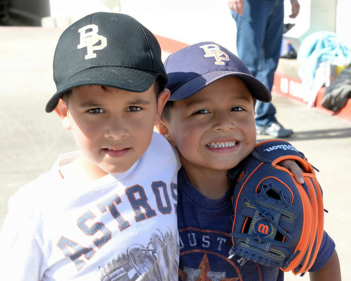 Astros fans Peyton Hernandes (age 6) and Kolbe Hernandes (age 5) wait in line for a chance to get an autograph from Jose Altuve at the Academy Sports+Oudoors in Katy on Monday, November 20, 2017.
