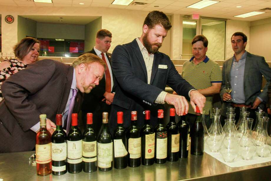 Spec's owner John Rydman, left, and Master Sommelier David Keck prepare for the tasting. Photo: Gary Fountain, For The Chronicle / Copyright 2017 Gary Fountain