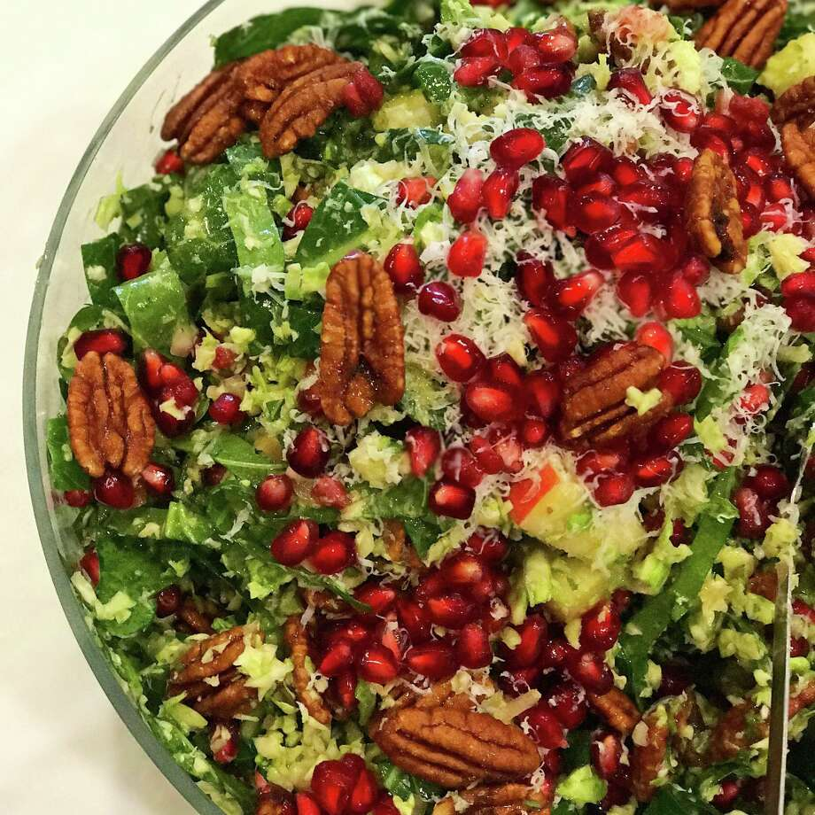 Begin Thanksgiving with a salad whose texture and color comes from  pecans, pomegranates and apples. Photo: Marcia Smart