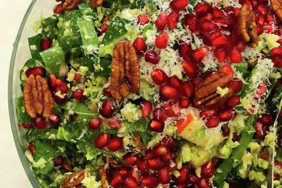 Begin Thanksgiving with a salad whose texture and color comes from  pecans, pomegranates and apples.