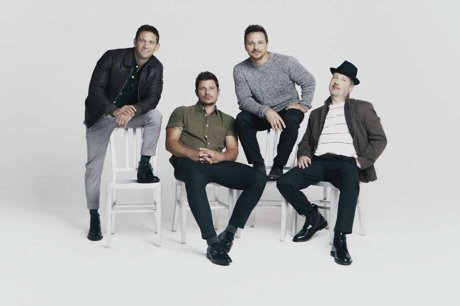 98 Degrees performs at Foxwoods Resort Casino on Nov. 24. From left are Jeff Timmons, Nick Lachey, Drew Lachey and Justin Jeffre. Photo: Elias Tahan / Contributed Photo