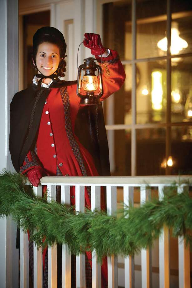 Lantern Light Tours at Mystic Seaport will begin Nov. 24, and run several evenings through Dec. 23. The re-created fishing village will be suspended in time, always Christmas Eve 1876. Photo: Floyd Dean / Contributed Photo / Copyright:DeanDigital 2009