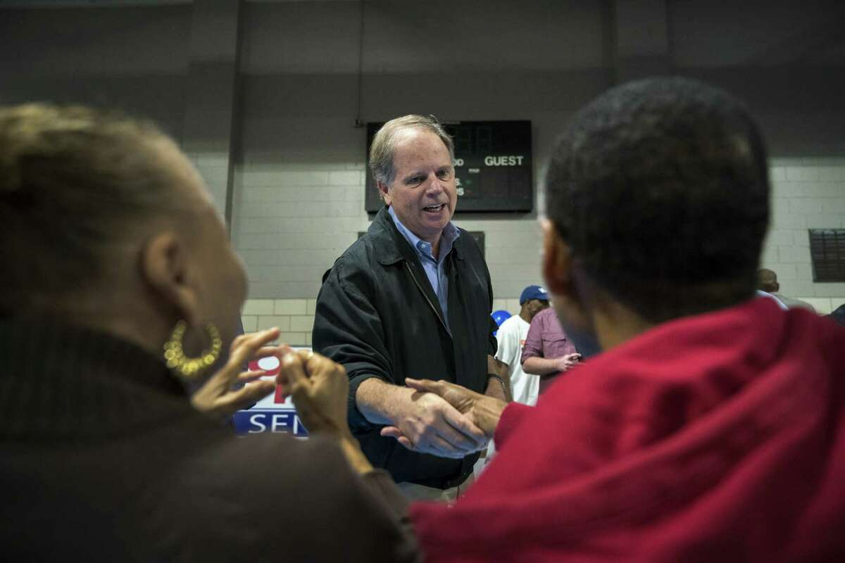 BIRMINGHAM, AL - NOVEMBER 18: Democratic candidate for U.S. Senate Doug Jones greets supporters before speaking at a fish fry campaign event at Ensley Park, November 18, 2017 in Birmingham, Alabama. Jones has moved ahead in the polls of his Republican opponent Roy Moore, whose campaign has been rocked by multiple allegations of sexual misconduct. (Photo by Drew Angerer/Getty Images) ORG XMIT: 775080537