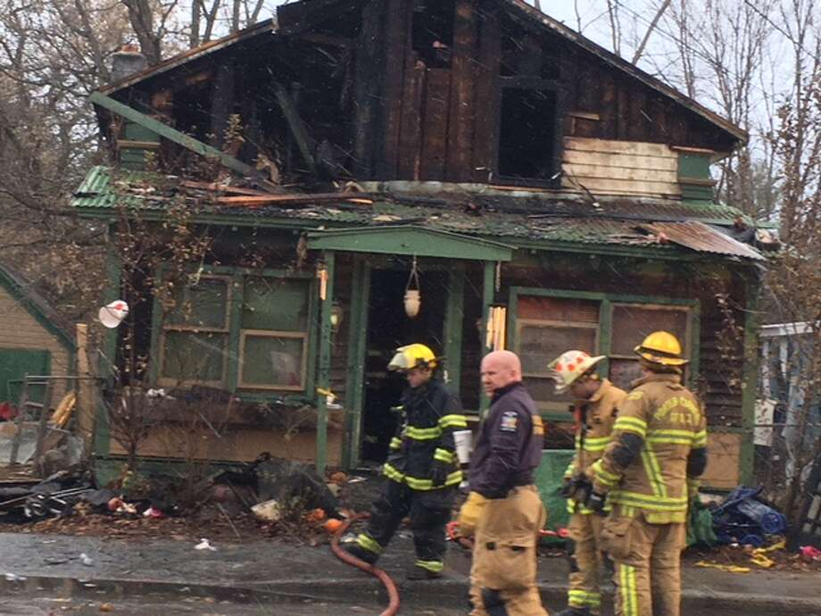 A home at 418 Main St. was gutted on Monday, killing a mother and daughter. Photo: Wendy Liberatore/Times Union