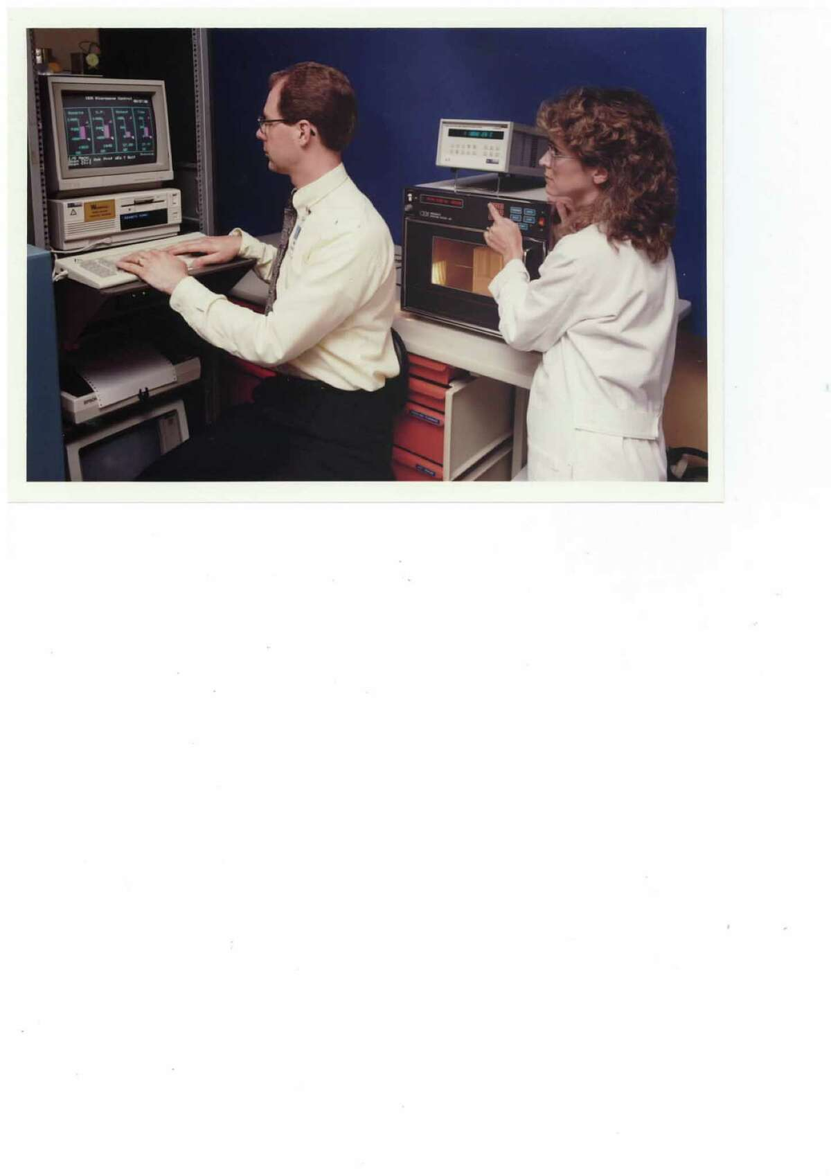 Holly Comanzo and her colleague Bill Schultz experiment with microwave sintering of ZnO Varistor Ceramics in the 1980s. (Photo provided)
