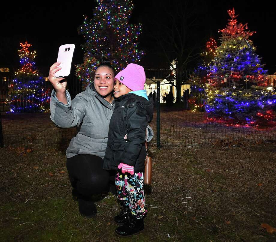 A West Haven mother takes a selfie with her child following the annual lighting of the Christmas tree on the Green in West Haven, Saturday, November 26, 2016. (Catherine Avalone/New Haven Register) Photo: Catherine Avalone / File Photo / New Haven RegisterThe Middletown Press