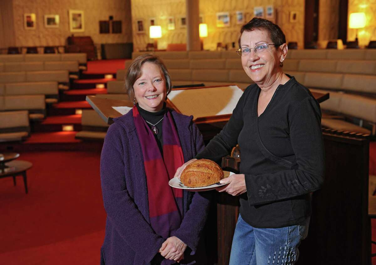 Rev. Margret O'Neall, left, and Lois Porter stand in the Schenectady Unitarian Universalist Society on Thursday, Nov. 19, 2015 in Schenectady, N.Y. (Lori Van Buren / Times Union)