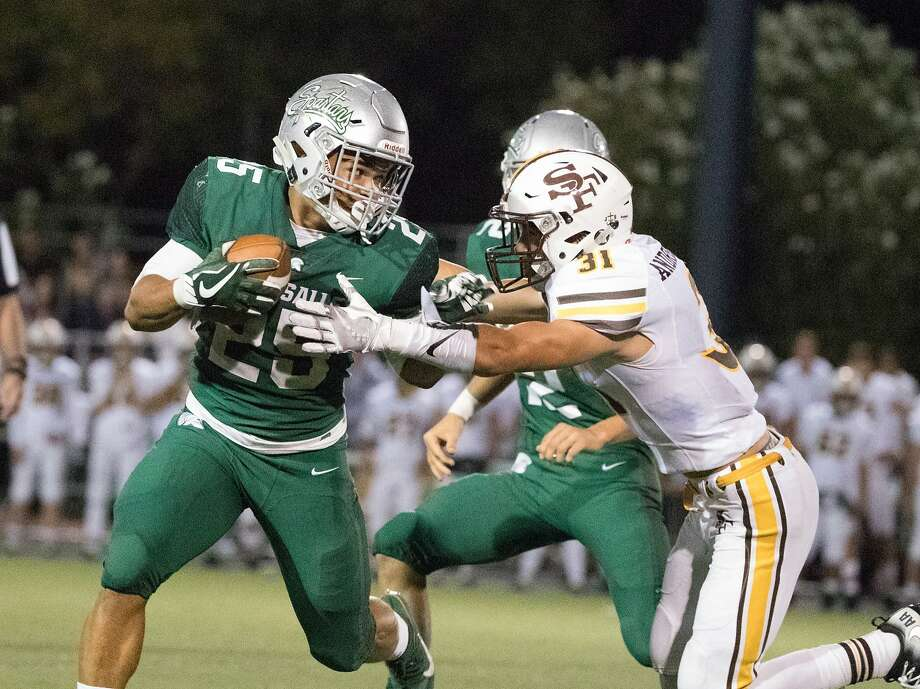 In 10 games this season, Kairee Robinson, left, is averaging 10.9 yards per carry for top-ranked De La Salle-Concord. Photo: Paul Kuroda, Special To The Chronicle