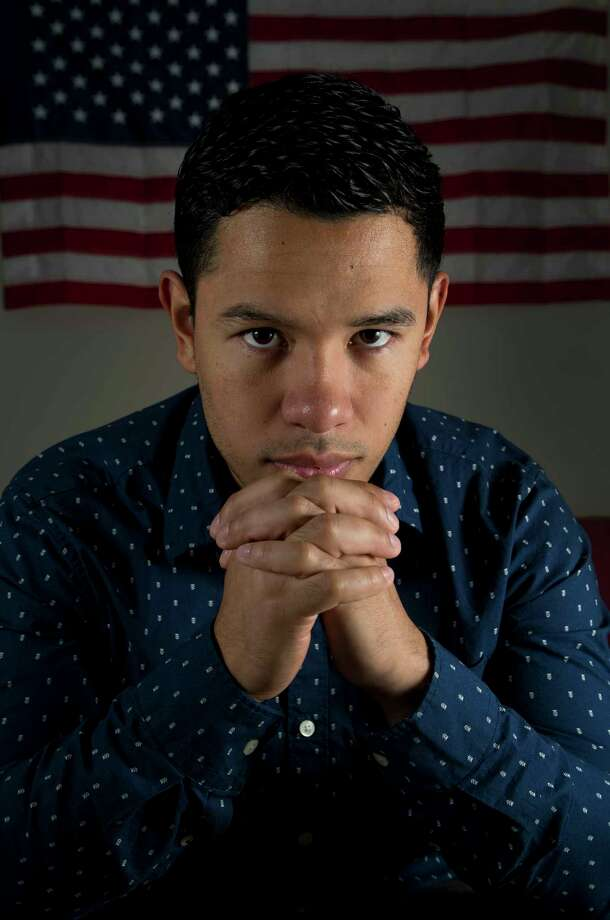 Jesus Contreras, a Deferred Action for Childhood Arrivals recipient, poses for a photograph inside his home Tuesday, Oct. 17, 2017, in Houston. Contreras is a paramedic for the Montgomery County Health Department and worked long hours during Tropical Storm Harvey. ( Godofredo A. Vasquez / Houston Chronicle ) Photo: Godofredo A. Vasquez, Houston Chronicle / Godofredo A. Vasquez