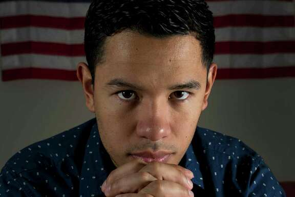 Jesus Contreras, a Deferred Action for Childhood Arrivals recipient, poses for a photograph inside his home Tuesday, Oct. 17, 2017, in Houston. Contreras is a paramedic for the Montgomery County Health Department and worked long hours during Tropical Storm Harvey. ( Godofredo A. Vasquez / Houston Chronicle )