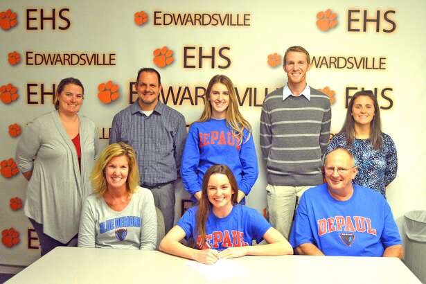 Edwardsville senior Lorie Cashdollar signed with DePaul University for track and field and for cross country. In the front row, from left to right, are mother Mary Jean Cashdollar, Lorie Cashdollar and father Bob Cashdollar. In the back row, from left to right, are EHS girls' track and field coach Camilla Eberlin, EHS cross country coach George Patrylak, sister Nickie Cashdollar, EHS assistant cross country and track and field coach Dustin Davis and EHS assistant cross country coach Maggie Dust.