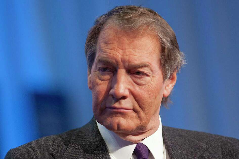 Charlie Rose, television personality, moderates a session at the 2010 World Economic Forum in Davos, Switzerland.