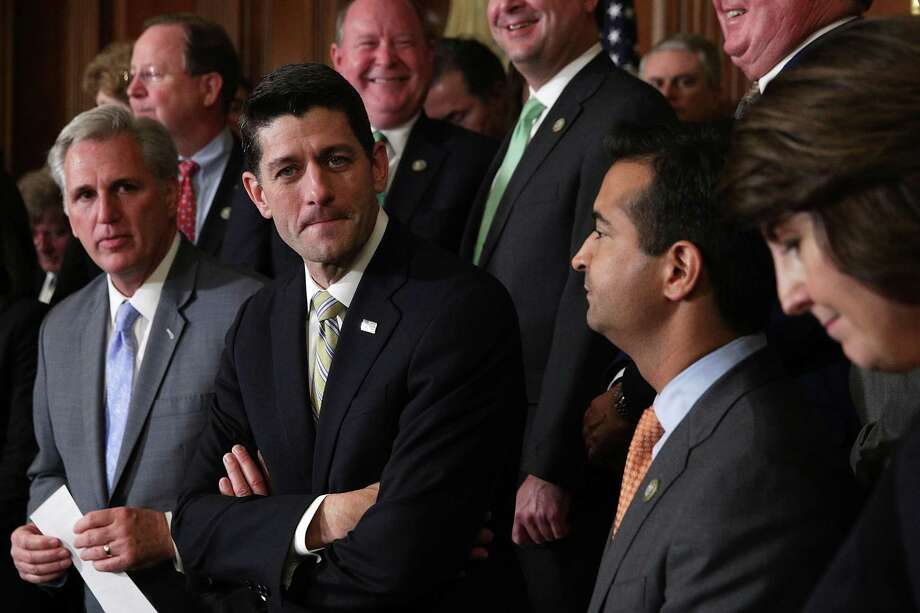 House Majority Leader Rep. Kevin McCarthy, Speaker of the House Rep. Paul Ryan, Rep. Carlos Curbelo and House Republican Conference Chair Rep. Cathy McMorris Rodgers during an event at the Capitol Thursday to celebrate the passing of the tax bill. Photo: Alex Wong /Getty Images / 2017 Getty Images