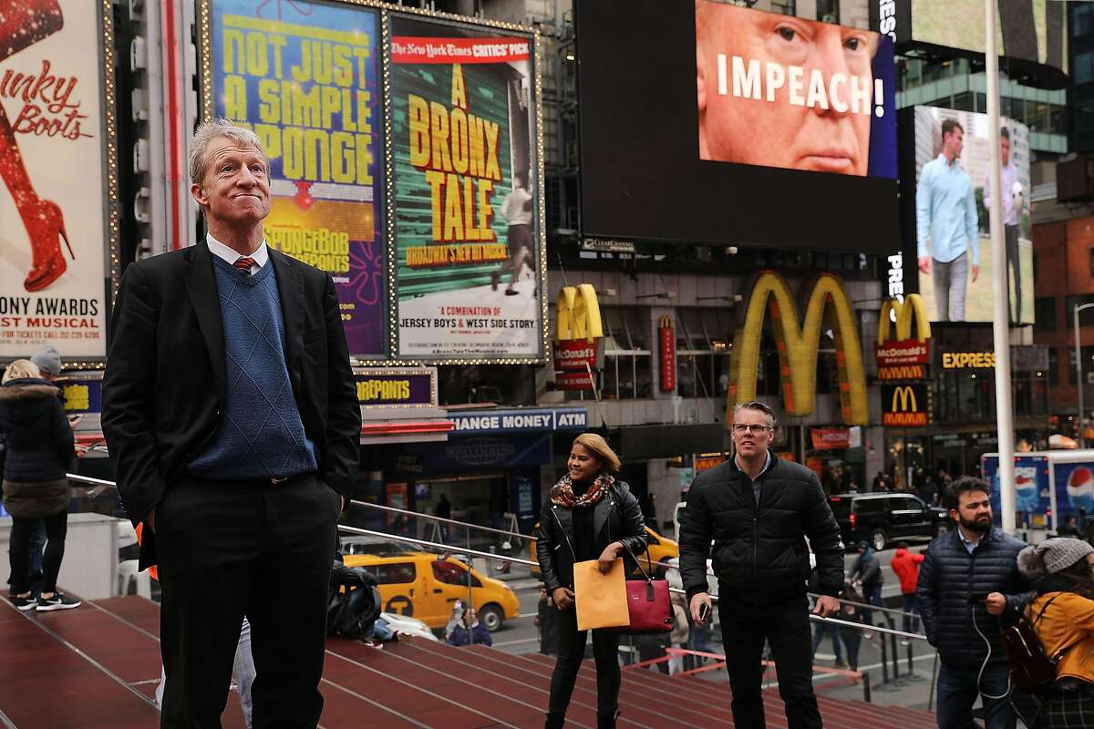 NEW YORK, NY - NOVEMBER 20: Philanthropist Tom Steyer stands in front of one of the billboards he has funded in Times Square calling for the impeachment of President Donald Trump on November 20, 2017 in New York City. Steyer, an American hedge fund manager, environmentalist, progressive activist, and fundraiser has pledged $20 million for an ad campaign urging for the impeachment of President Donald Trump. The billboards will go up in various locations across the United States. (Photo by Spencer Platt/Getty Images)