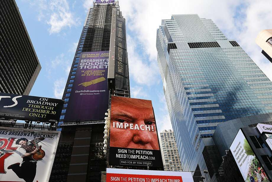 A billboard in Times Square, funded by Philanthropist Tom Steyer, calls for the impeachment of President Donald Trump on November 20, 2017 in New York City. Steyer, an American hedge fund manager, environmentalist, progressive activist, and fundraiser has pledged $20 million for an ad campaign urging for the impeachment of President Donald Trump. The billboards will go up in various locations across the United States. Photo: Spencer Platt, Getty Images