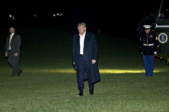 President Donald Trump walks on the South Lawn of the White House after returning from an 11-day Asia trip. A reader says Trump seems to do a lot of walking considering he cited foot problems during the Vietnam War.